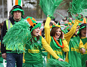 Ratoath, Ireland - March 17, 2010:  Schools girls dressed in Irish colors cheering up at the St Patrick's day parade in an Irish village.