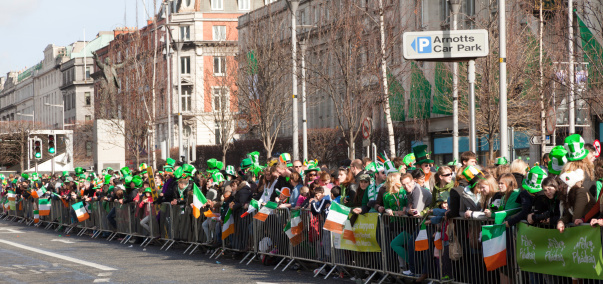 Dublin, Ireland - 17 March, 2011: People line the streets in the city of Dublin as they wait for St. Patrick\\'s Day Parade to begin.
