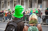 Dublin, Ireland - March 17, 2011: In Dublin locals and tourists line the streets awaiting the start of the St. Patricks Day Parade.