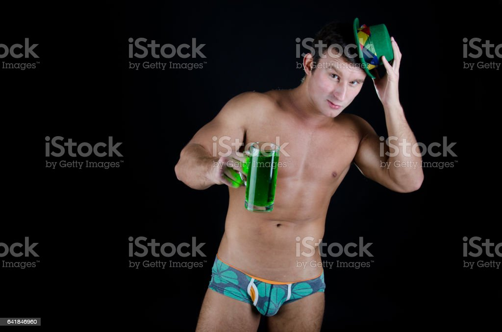 St. Patrick's day. Sexy guy with a beer. stock photo