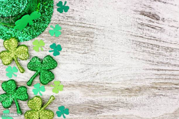 St patricks day side border of shamrocks leprechaun hat over white picture id1124859478?b=1&k=6&m=1124859478&s=612x612&h=po7z5m4qfkeih9b6mpdrjoztjbzmks4878qwi6pclua=