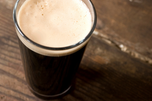 St Patricks Day Stout Pint On A Wooden Surface Stock Photo - Download Image Now