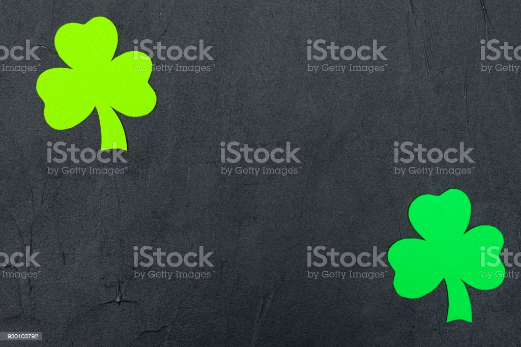 St. Patrick's Day theme colorful horizontal banner. Green shamrock leaves on black background. Felt craft elements. Copy space. For greeting card, banner stock photo