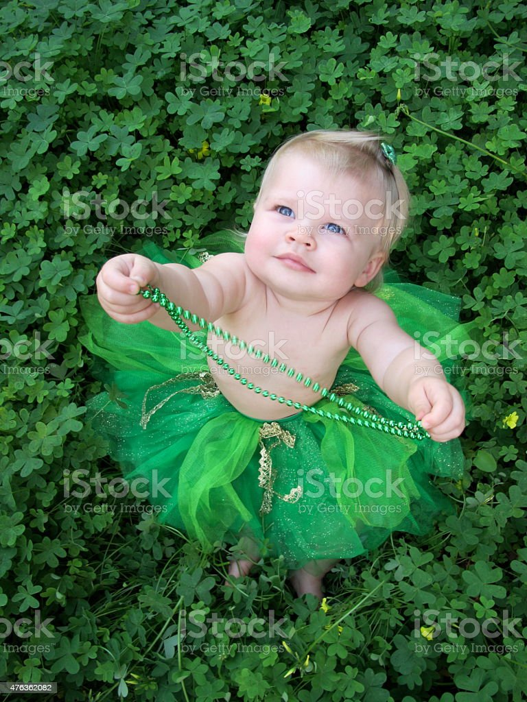 St. Patty's Day Baby Girl in Clovers stock photo