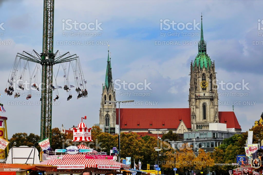St. Paul Church and the Jules-Verne-Tower carousel at the Oktoberfest. Munich, Bavaria. stock photo