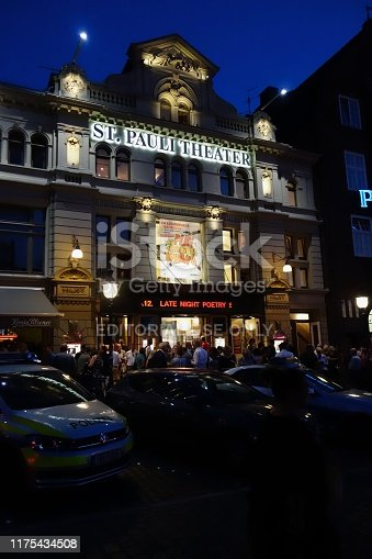 Hamburg, Germany, August 26, 2019: St. Pauli Theater in Hamburg at night. Some unidentified people in the Background.