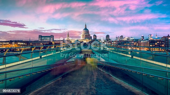 St Pauls Cathedral and Millennium bridge at dusk in London, UK.
