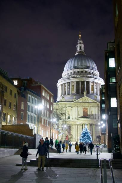 St Paul's Cathedral at Christmas Christmas tree outside St Pauls, London. Taken from Peter's Hill. skeable stock pictures, royalty-free photos & images