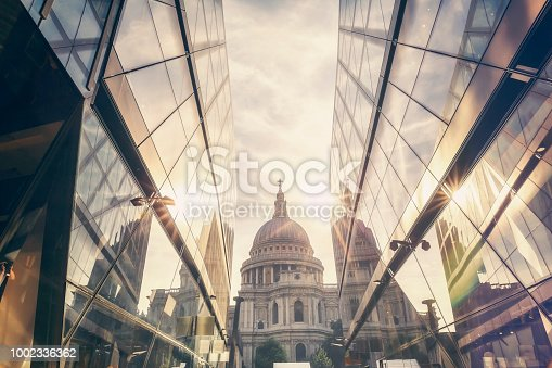 View of St Paul's Cathedral with the sun setting behind its dome in London