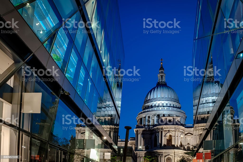 St Paul's cathedral from a narrow alley with glass buildings stock photo