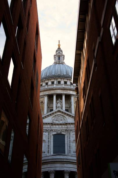 St Paul's Cathedral, London St Paul's as seen from Canon Alley, between two brick buildings skeable stock pictures, royalty-free photos & images
