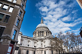 St Paul's Cathedral between buildings, London, UK.