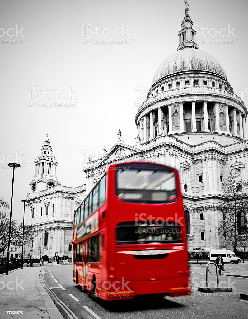 St Paul's Cathedral with red tour bus in front  stock photo