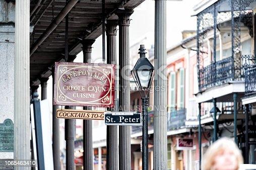 938895626 istock photo St Peter Pierre street sidewalk in Louisiana town, city, building, sign closeup for Cafe Pontalba, creole cajun cuisine 1065463410