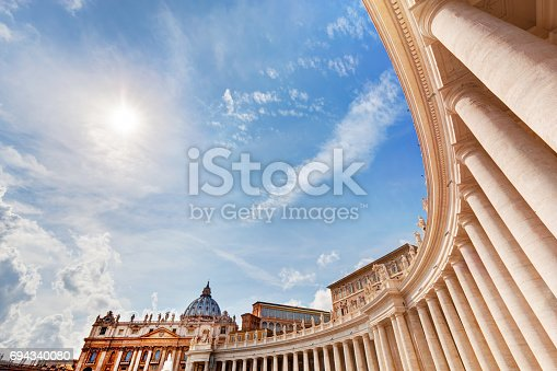 St. Peter's Basilica colonnades, columns in Vatican City. Blue sunny sky