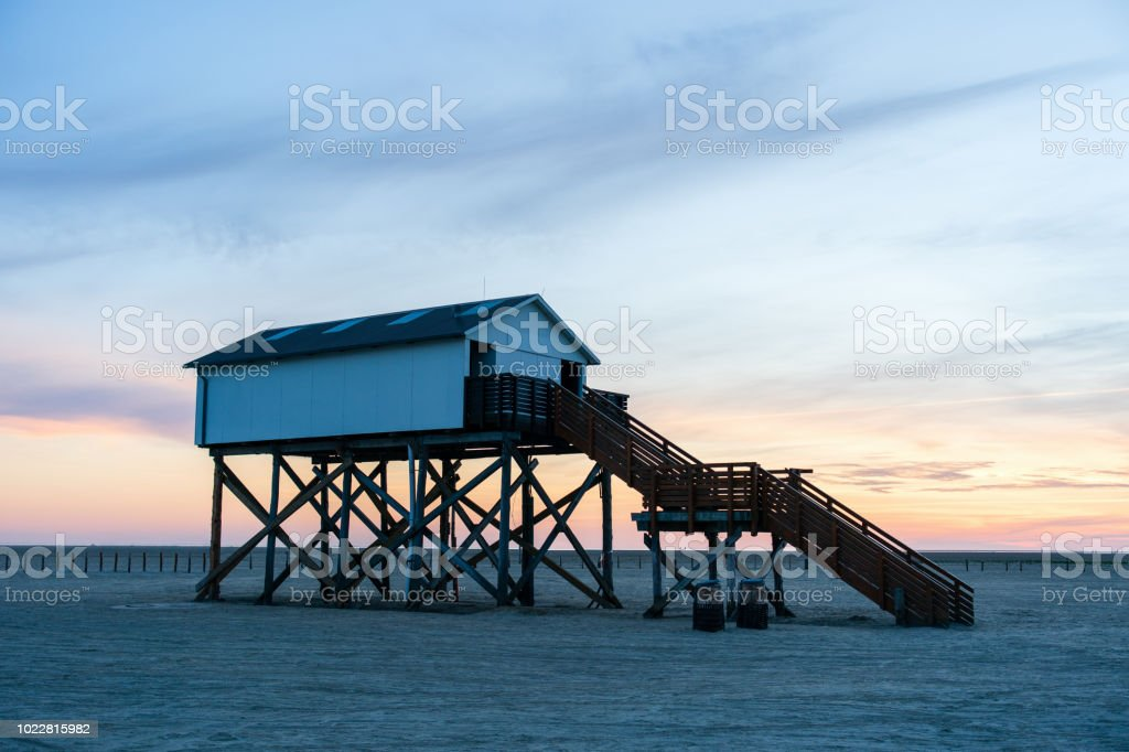 St. Peter-Ording Beach Sunset Pile Dwelling North Sea Germany stock photo