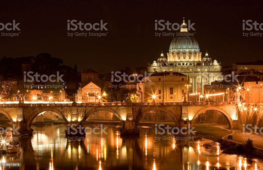 St. Peter's Basilica and a bridge on Tiber River royalty-free stock photo