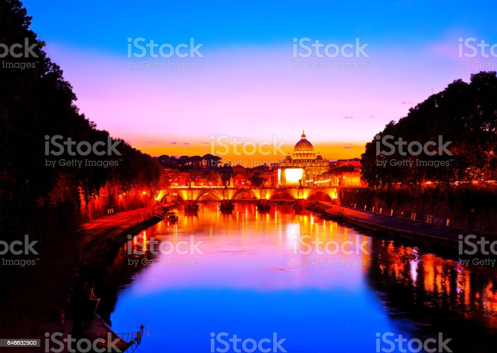 St. Peter's Basilica and Aelian Bridge at dusk in Rome stock photo