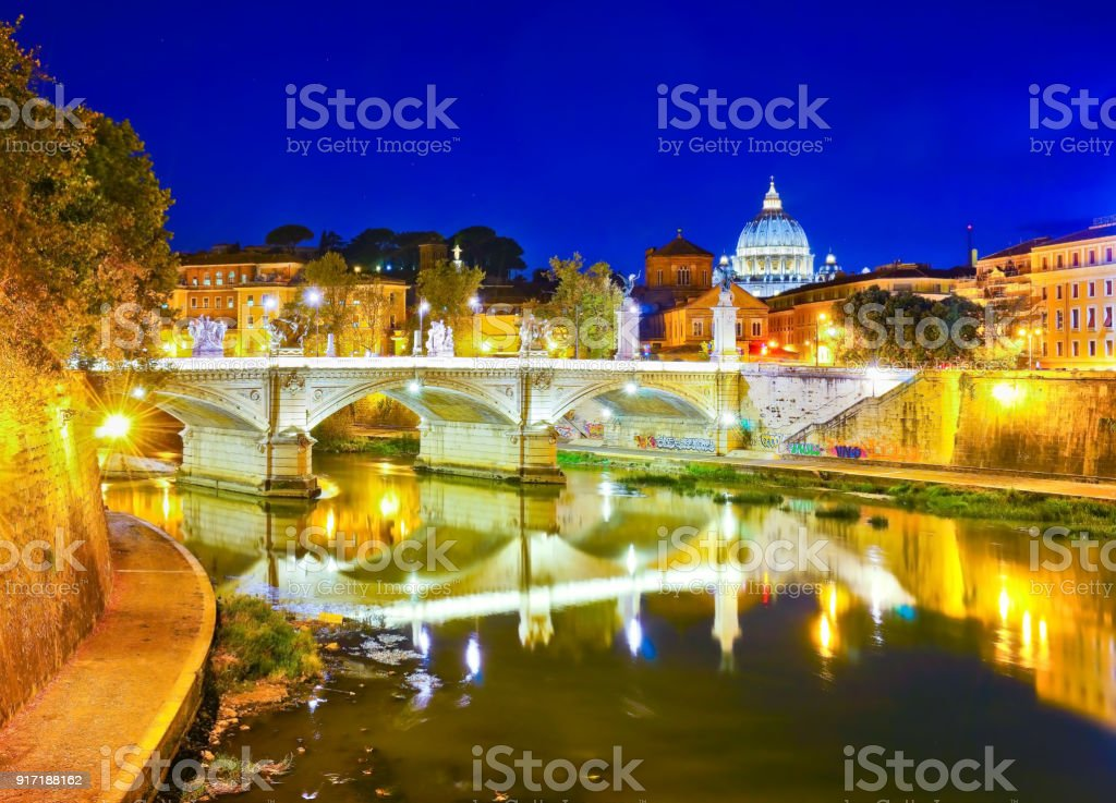 St. Peter's Basilica and Bridge King Victor Emmanuel II in Rome at night stock photo