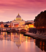 Sunset of St Peter's Basilica tiber river and Rome cityscape, Vatican, Rome, Italy.