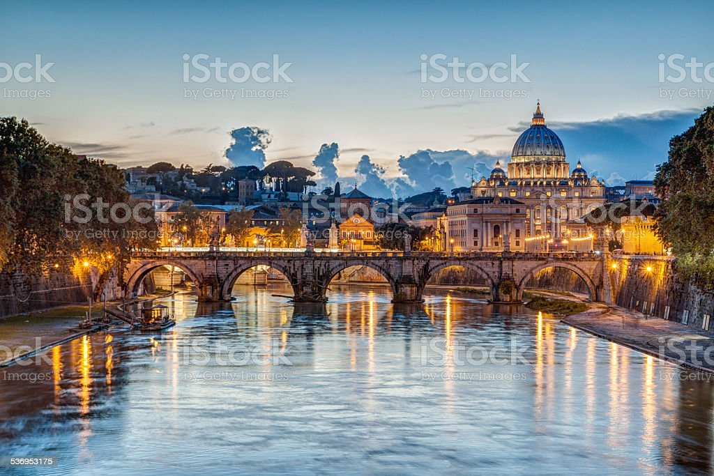 St. Peter's Basilica at dusk in Rome, Italy stock photo