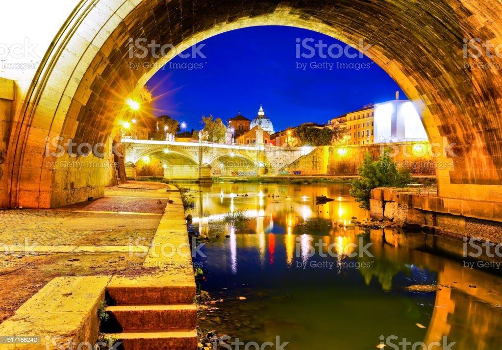 St. Peter's Basilica from Aelian Bridge in Rome at night. stock photo
