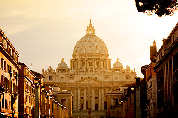 St. Peter's Basilica In Vatican Vatican City, Vatican City State - August 21, 2008: St. Peter's Basilica at sunset from Via della Conciliazione. Vatican City State. Rome, Italy. basilica stock pictures, royalty-free photos & images