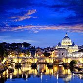 St. Peter's Basilica in Vatican and Tiber river in Rome at sunset. Composite photo
