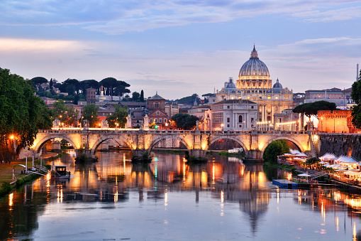 St. Peter's Basilica in Vatican and Tiber river in Rome at sunset