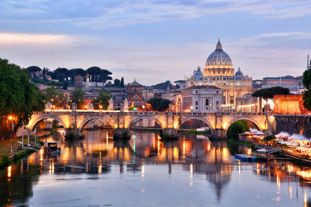 St. Peter's Basilica, Vatican St. Peter's Basilica in Vatican and Tiber river in Rome at sunset basilica stock pictures, royalty-free photos & images