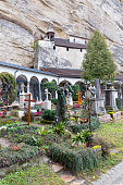 Salzburg, Austria - March 10, 2019 : St. Peter's Cemetery known as Petersfriedhof. It is the oldest cemetery in Salzburg, located at the foot of the Festungsberg with Hohensalzburg Castle