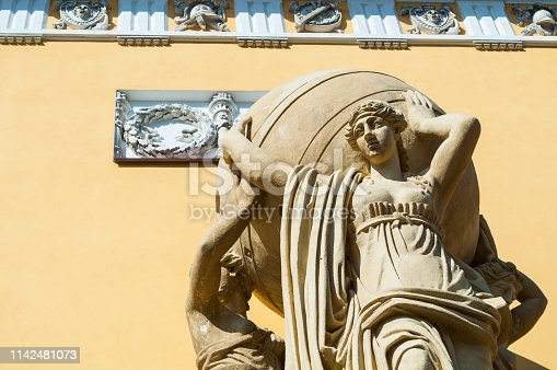 St Petersburg Russia. Fragment of building of Main Admiralty built in 1813. Sculpture of sea nymphs holding the globe, closeup of St Petersburg landmark
