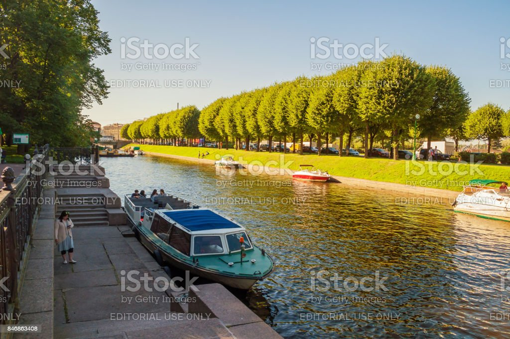 St Petersburg, Russia with touristic pleasure boats on Moika river stock photo