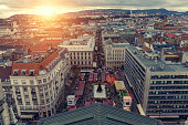 Aerial cityscape of Budapest with landmarks buildings including Castle Hill and St Stephen's Basilica Sqaure at sunset