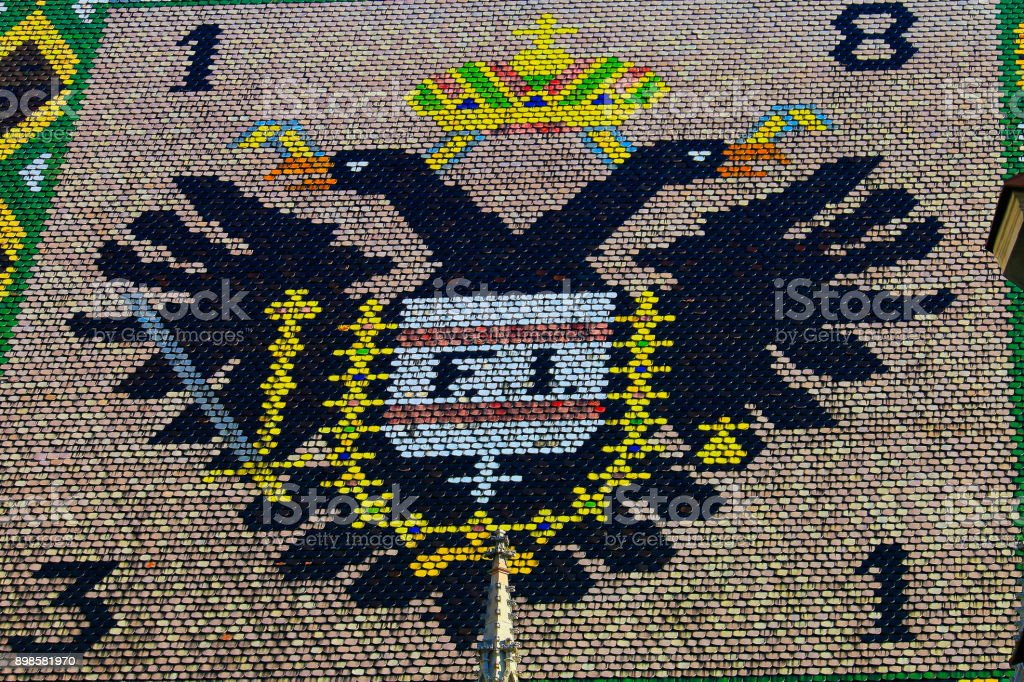 St. Stephen's Cathedral roof,  double-headed eagle empire close-up pattern – Vienna , Austria stock photo