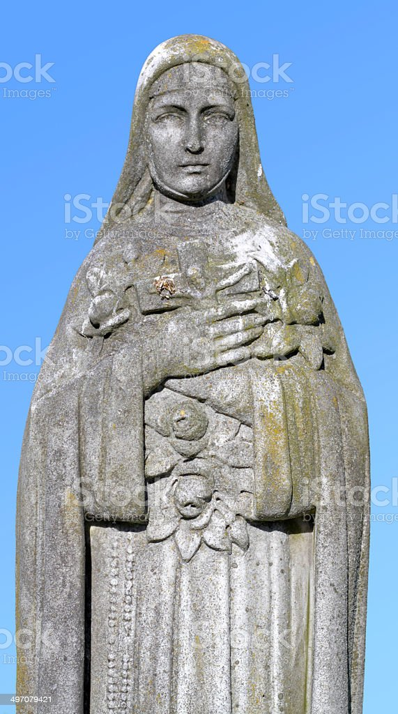St. Therese of Lisieux and Jesus on the cross statue royalty-free stock photo