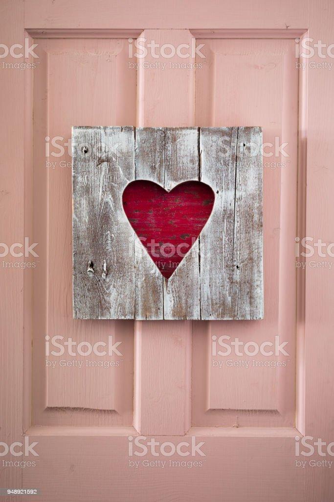 St. Valentine handmade wooden heart panel on the door stock photo