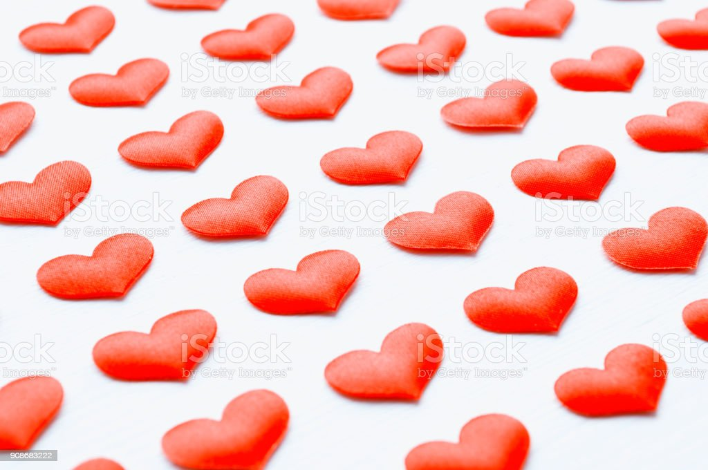St Valentines day background. Red silk hearts stock photo