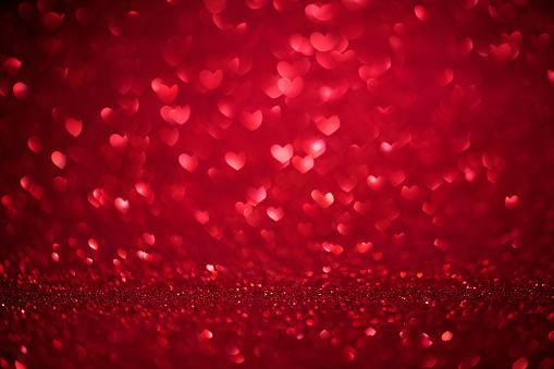 St. Valentine's Day red bokeh background with love heart, place for text