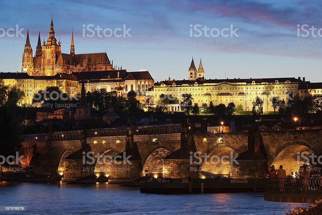 St. Vitus and Charles Bridge at night. stock photo