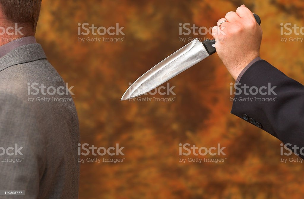 Stabbed in the back stock photo