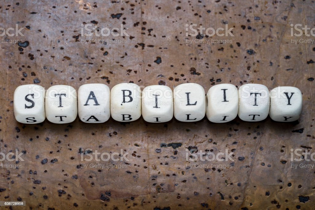 Stability text on wooden cubes stock photo