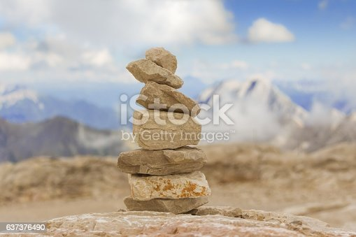 istock Stable stone tower in mountains show balance stability power 637376490