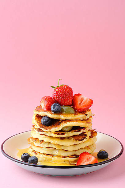 stack breakfast pancakes with berries stock photo