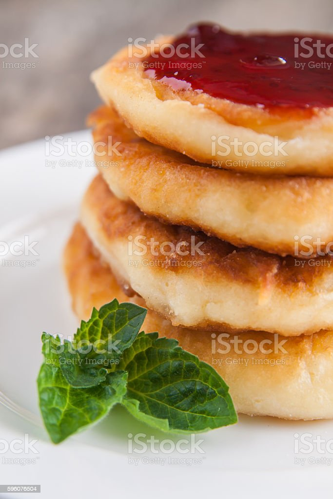 stack cheesecakes with jam on  white plate on dark wooden royalty-free stock photo