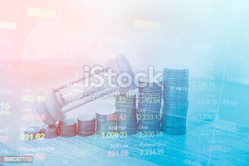 istock Stack coin money finance and banking with profit graph of stock market trade indicator financial.Double exposure style 696087110
