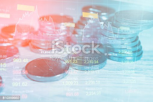 istock Stack coin money finance and banking with profit graph of stock market trade indicator financial 810359932
