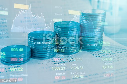 821678930 istock photo Stack coin money with account book finance and banking with profit graph of stock market trade indicator financial.Double exposure style 802782718
