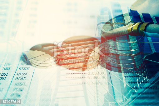821678930 istock photo Stack coin money with city background 671077614
