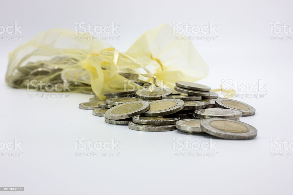 Stack Coins Thailand And A Bag Of Coins Isolate Of Saving